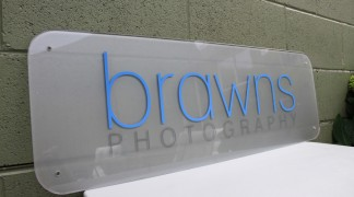 Clear plexi, with frosted etch vinyl on the back and cut vinyl text.