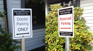 Parking signs, aluminum and mounted on highway quality posts.