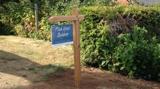 Home based business sign, two sided outdoor plywood with laminated digital prints, and a hand made cedar post.