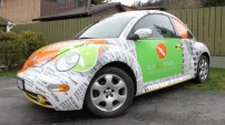 A beetle full wrap, print ads on the front, web ads on the back.
