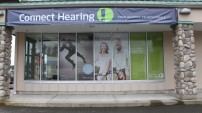 Connect Hearing Port Alberni, 6 big panels of perforated window film on the side.