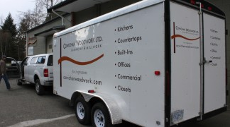 Big, two colour cut vinyl works great on this white trailer.